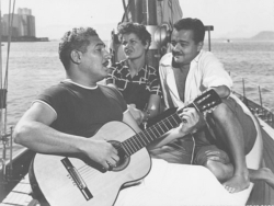 Dorival Caymmi and Carlos Guinle (with an unidentified lady on Guinle's sailboat Laffite)